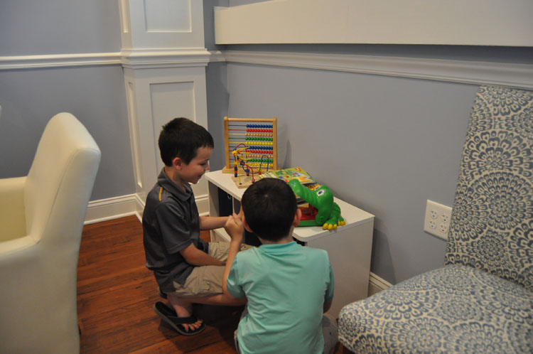 Children Playing with Toys at Dentist Office