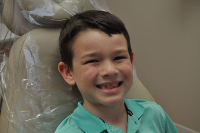 Boy in Dentist Chair Smiling